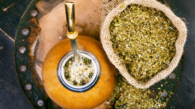 Yerba Mate Tea Leaves with a Traditional Hollowed Wood Mate