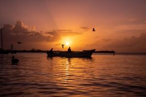 A fisherman at sunset in Caye Caulker, Belize