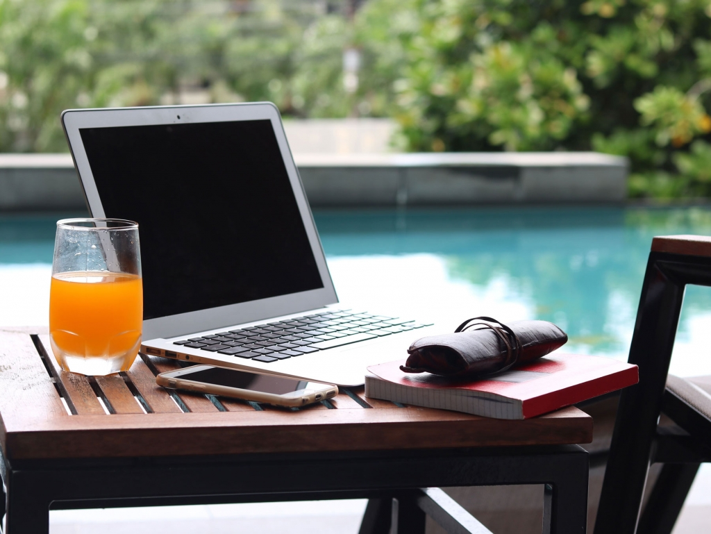 Computer next to pool